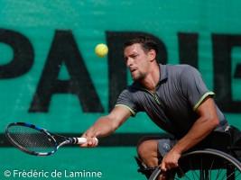 Belgium's Joachim Gérard in action during his men's wheelchair singles final match against France's Nicolas Peifer on day 5 of the  2015 Belgian Open tennis tournament in Géronsart(Namur) on August 1st, 2015.