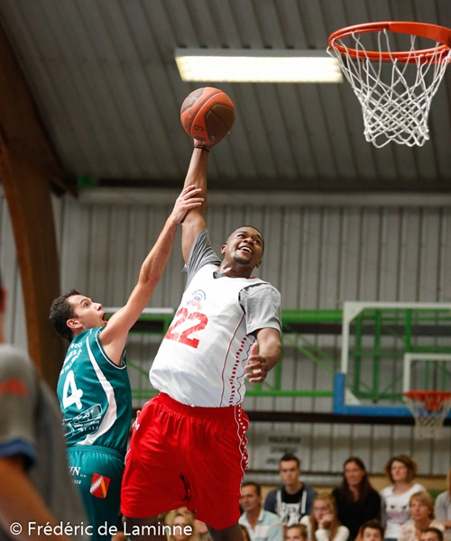 20140815 - Belgrade, Belgium : Kristopher Jenkins (22)  from Global Sports Academy (US) attempts a dunk but is blocked by Selim BECA (4)  from New BC Alsavin Belgrade during the Friendly game between Belgrade (BE) and Global Sports Academy (US) on 15/08/2014 in Belgrade (hall José Tyssaen)