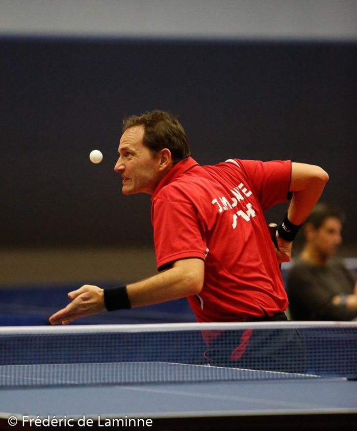 1/2 finale hommes entre Jean-Michel SAIVE(rouge) et Cedric NUYTINCK (noir) lors du Championnat de Belgique de Tennis de Table in Andenne, Andenne Arena on Sunday, March 2, 2014.