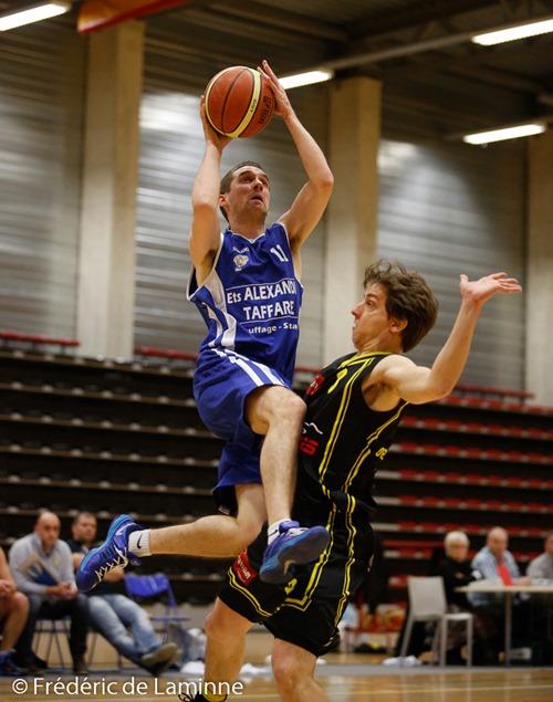 A GARRAUX (11)  du BC Ciney bouscule Jérôme DECOCQ (8)  de Andenne Basket lors du Match de Basket-ball R2: Andenne-Ciney  a Andenne (Andenne Arena) le Saturday, March 15, 2014.