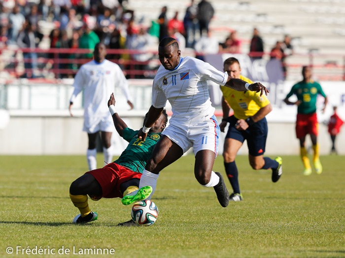 20150609 - Mons, Belgium : Cameroun's defender Mandjan KOMBI (#22) attempts a tackle on DR Congo's forward Yannick BOLASOE (#11) during the friendly football game between Democratic Replublic of Congo and Cameroun on 09/06/2015 in Mons (Albert)