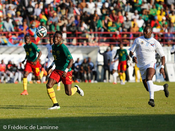 20150609 - Mons, Belgium : Cameroun's defender Mandjan KOMBI (#22) is chased by DR Congo's forward Yannick BOLASOE (#11) during the friendly football game between Democratic Replublic of Congo and Cameroun on 09/06/2015 in Mons (Albert)