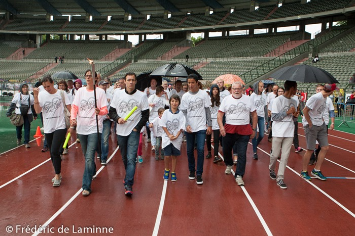 "Kim Gevaert, Tia Hellebaut and Cedric Van Branteghem march in front of people for ""Solidarity Athletics"" a movement to save the King Baudouin stadium in Brussels. March took place during the finals of the Belgian Athletics Championship 2015 on 26/07/2015 in Brussels (Boudewijnstadion/ Stade Roi Baudouin)"