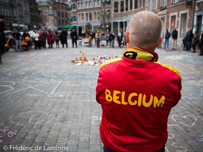 "Namur, Belgium. 25 Mar, 2016. A bystander wearing a ""Belgium"" vest is seen during the Tribute to the victims of March 22nd terrorist attacks on Brussels in Namur, Belgium. © Frédéric de Laminne"