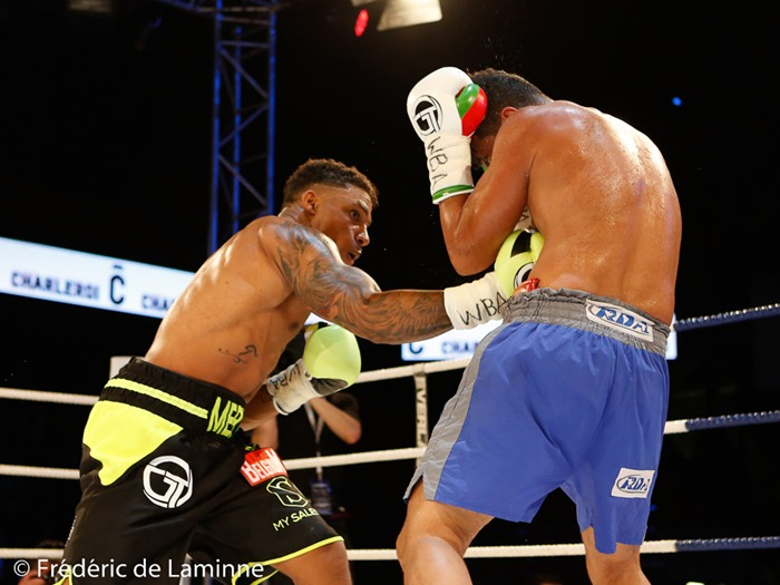 Charleroi, Belgium. 21 May, 2016. Ryad Merhy (Belgium) hits Williams Ocando (Venezuela) during the fight for the WBA Inter-Continental cruiserweight title in Charleroi, Belgium. © Frédéric de Laminne